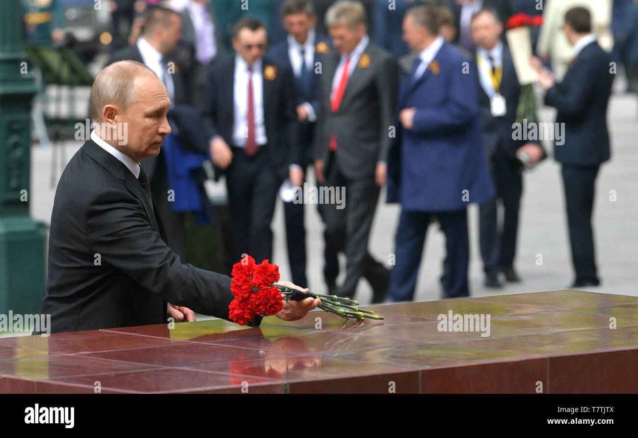 Moscow, Russia. 09th May, 2019. Russian President Vladimir Putin places red carnations on the Tomb of the Unknown soldiers during a ceremony following the annual Victory Day military parade marking the 74th anniversary of the end of World War II in Red Square May 9, 2019 in Moscow, Russia. Russia celebrates the annual event known as the Victory in the Great Patriotic War with parades and a national address by President Vladimir Putin. Credit: Planetpix/Alamy Live News - Stock Image