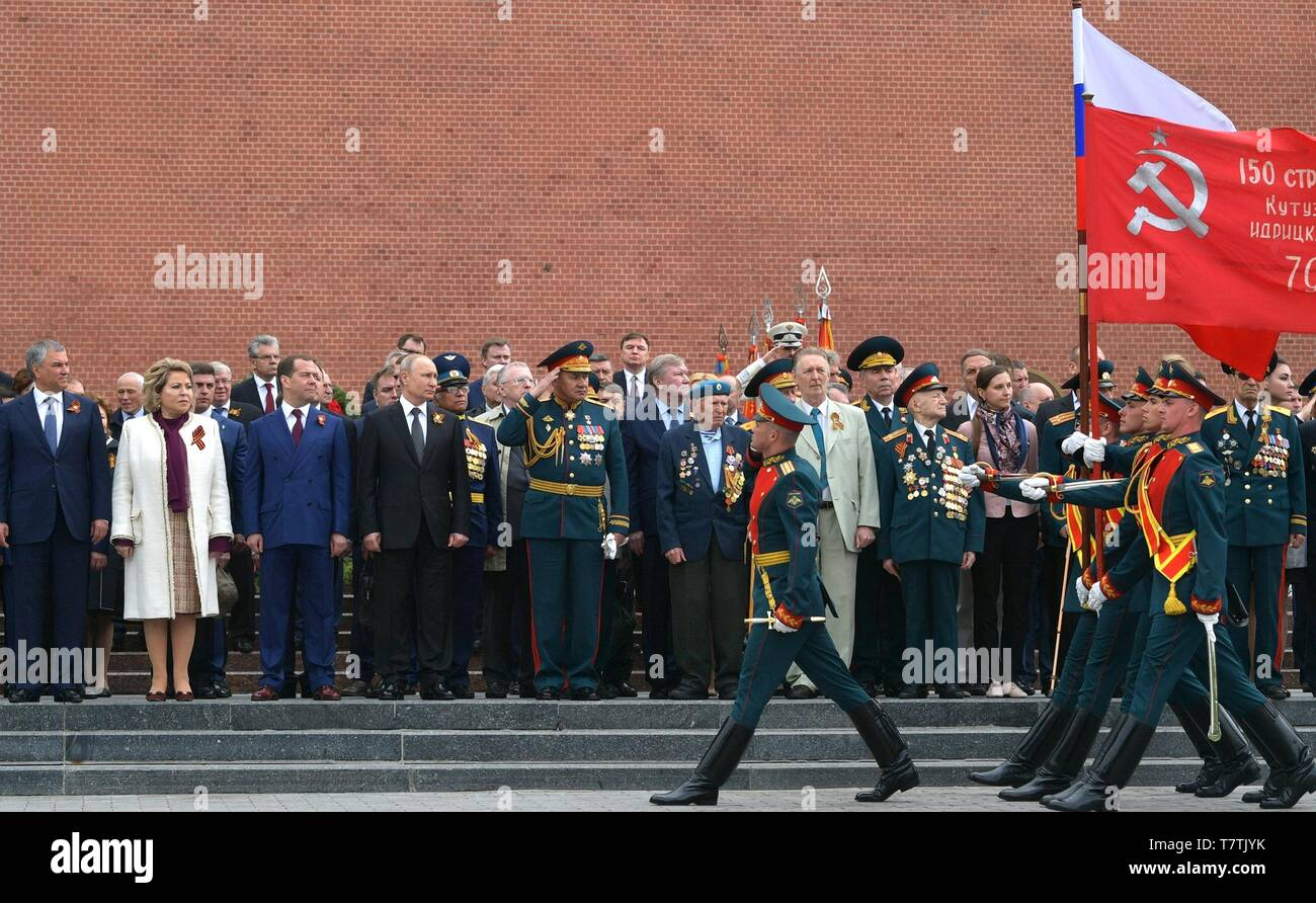 Moscow, Russia. 09th May, 2019. Russian President Vladimir Putin and guests during a wreath ceremony at the Tomb of the Unknown Soldier following the annual Victory Day military parade marking the 74th anniversary of the end of World War II in Red Square May 9, 2019 in Moscow, Russia. Standing from left, are Federation Council speaker Valentina Matvienko, Russian Prime Minister Dmitry Medvedev, President Vladimir Putin and Defence Minister Sergei Shoigu. Credit: Planetpix/Alamy Live News - Stock Image