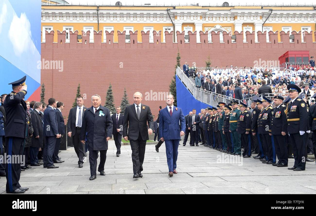 Moscow, Russia. 09th May, 2019. Russian President Vladimir Putin, center, walks with Prime Minister Dmitry Medvedev, right, and former Kazakh President Nursultan Nazarbayev as they arrive for the annual Victory Day military parade marking the 74th anniversary of the end of World War II in Red Square May 9, 2019 in Moscow, Russia. Credit: Planetpix/Alamy Live News - Stock Image