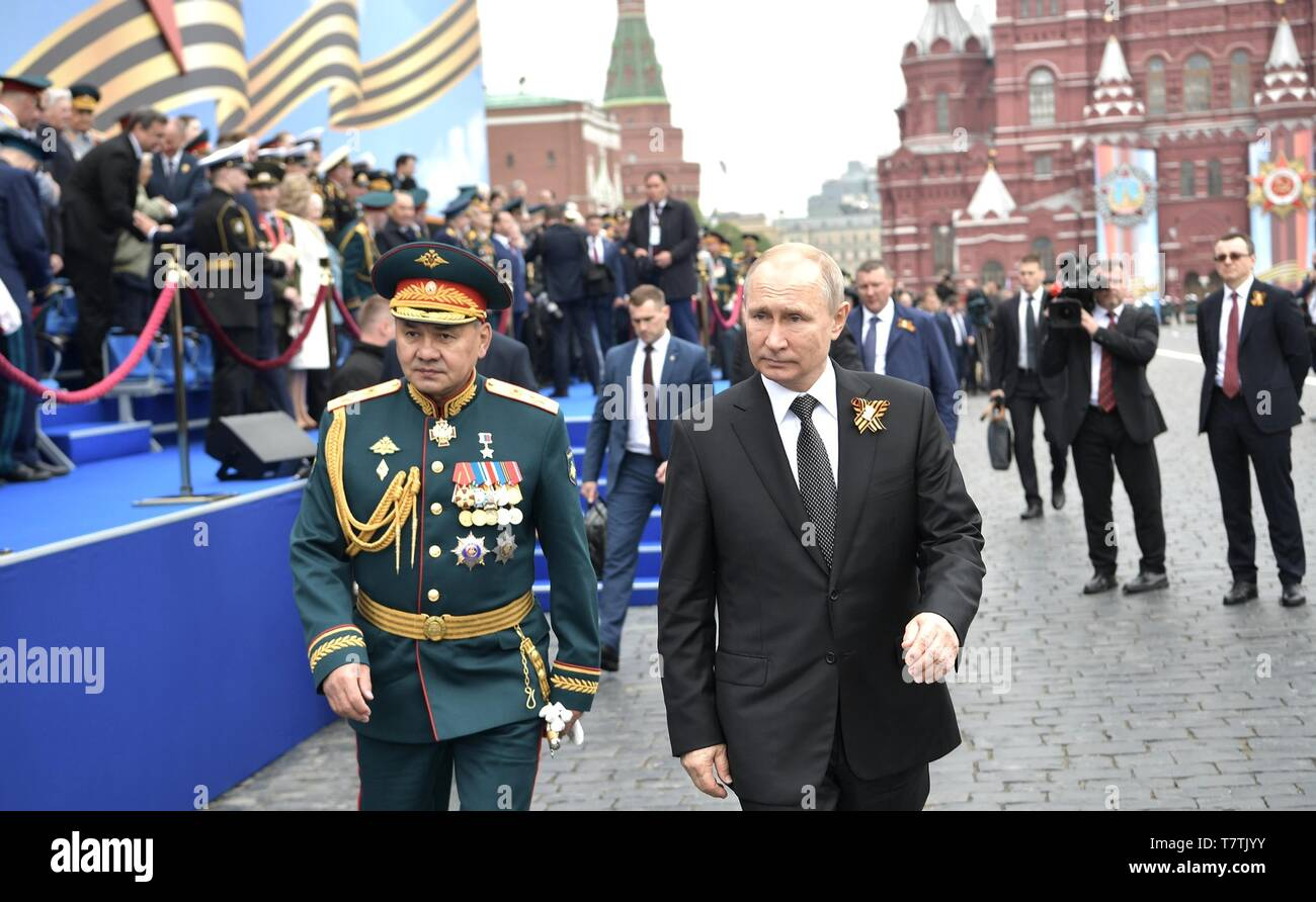 Moscow, Russia. 09th May, 2019. Russian President Vladimir Putin, right, walks with Defence Minister Sergei Shoigu following the annual Victory Day military parade marking the 74th anniversary of the end of World War II in Red Square May 9, 2019 in Moscow, Russia. Credit: Planetpix/Alamy Live News - Stock Image