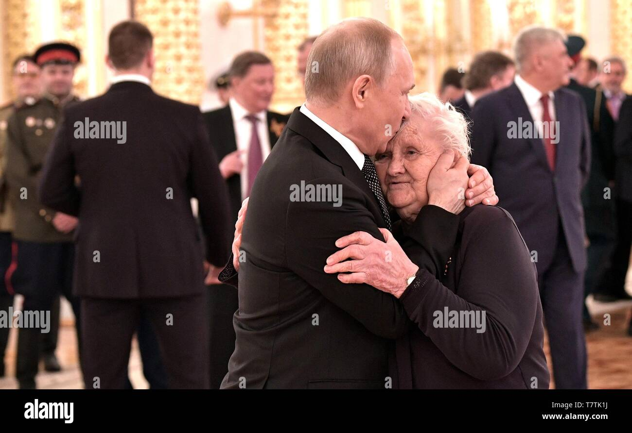 Moscow, Russia. 09th May, 2019. Russian President Vladimir Putin embraces his former school teacher, Vera Gurevich, during a reception marking the 74th anniversary of the end of World War II at the Kremlin May 9, 2019 in Moscow, Russia. Credit: Planetpix/Alamy Live News - Stock Image