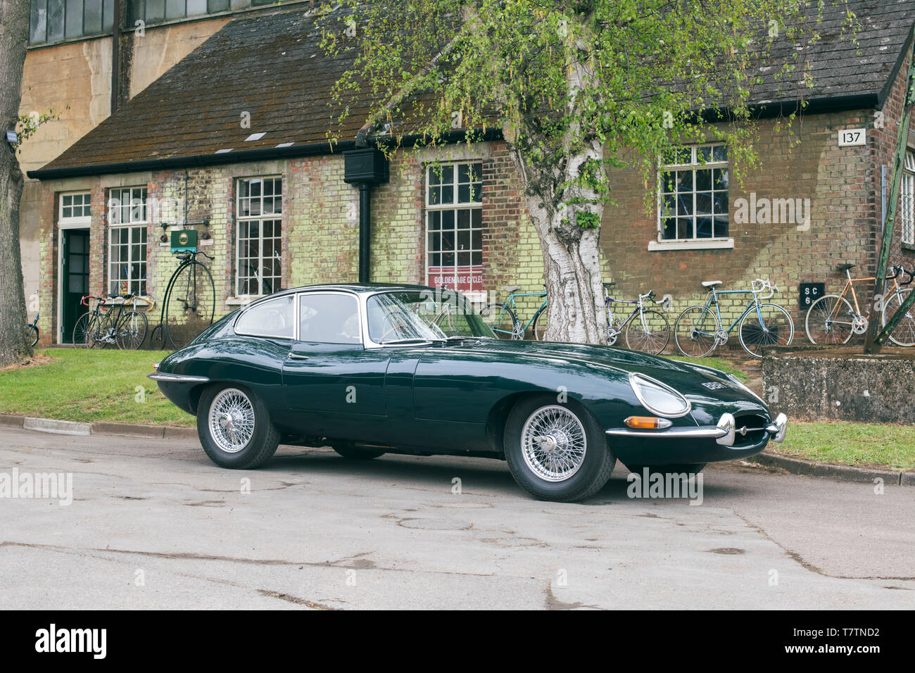 1965 E Type Jaguar car at Bicester Heritage centre 'Drive it day'. Bicester, Oxfordshire, England - Stock Image