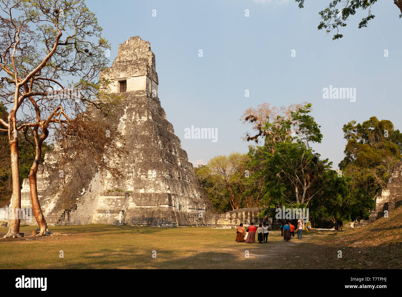 Local people in traditional dress and Temple 1, or Temple of the Great Jaguar, a ruined mayan temple,Tikal National Park, Guatemala Central America - Stock Image