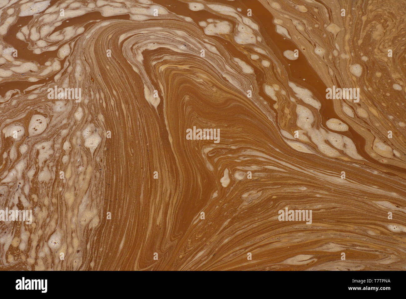 Abstract drawings drawn in a puddle of mud, an ideal image to use as a neutral background. - Stock Image