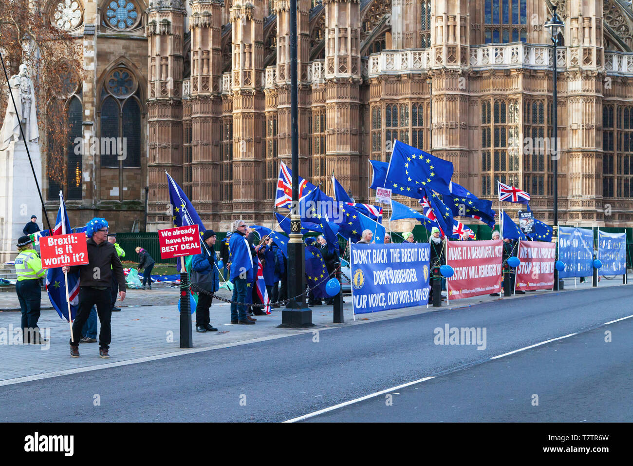 London, United Kingdom - December 19, 2018: Demonstrators against Brexit hold placards and European Union flags in front of the Houses of Parliament o - Stock Image