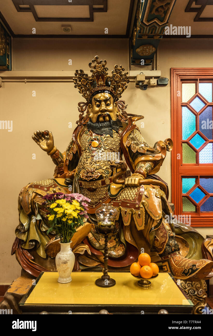 Hong Kong, China - March 7, 2019: Lantau Island. Po Lin Buddhist Monastery. Extensively decorated statue of West heavenly king, Virupaksa offers shade - Stock Image