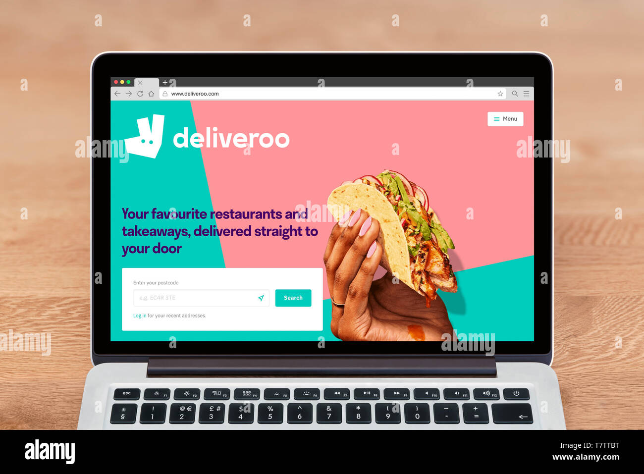An Apple Macbook displays the Deliveroo website (Editorial use only). - Stock Image