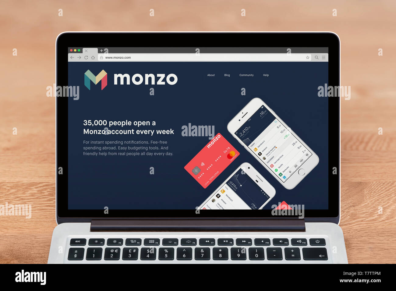 An Apple Macbook displays the Monzo Bank website (Editorial use only). - Stock Image