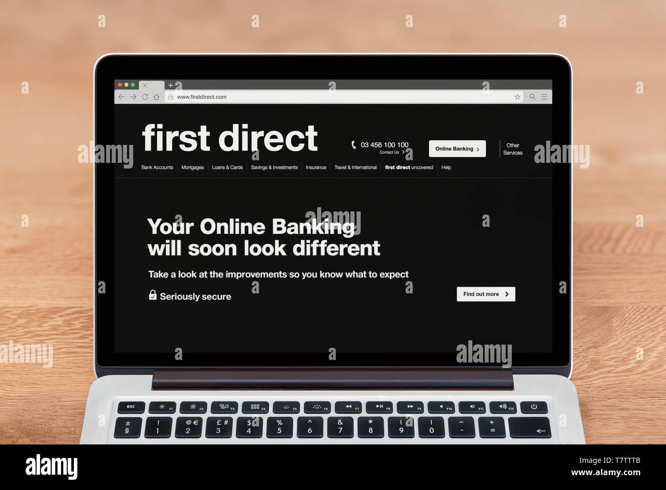 An Apple Macbook displays the First Direct bank website (Editorial use only). - Stock Image