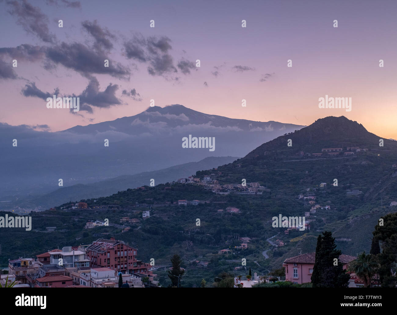 View of Mount Etna at sunset from Taormina, Sicily. - Stock Image