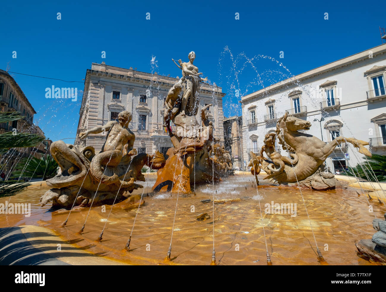 Artemis Fountain  (Diana Fountain) on Archimedes Square (Piazza Archimede)  Ortygia island, Syracuse, Sicily, Italy. - Stock Image