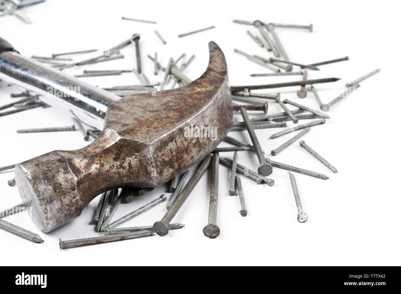 Claw hammer and nails on white background. - Stock Image