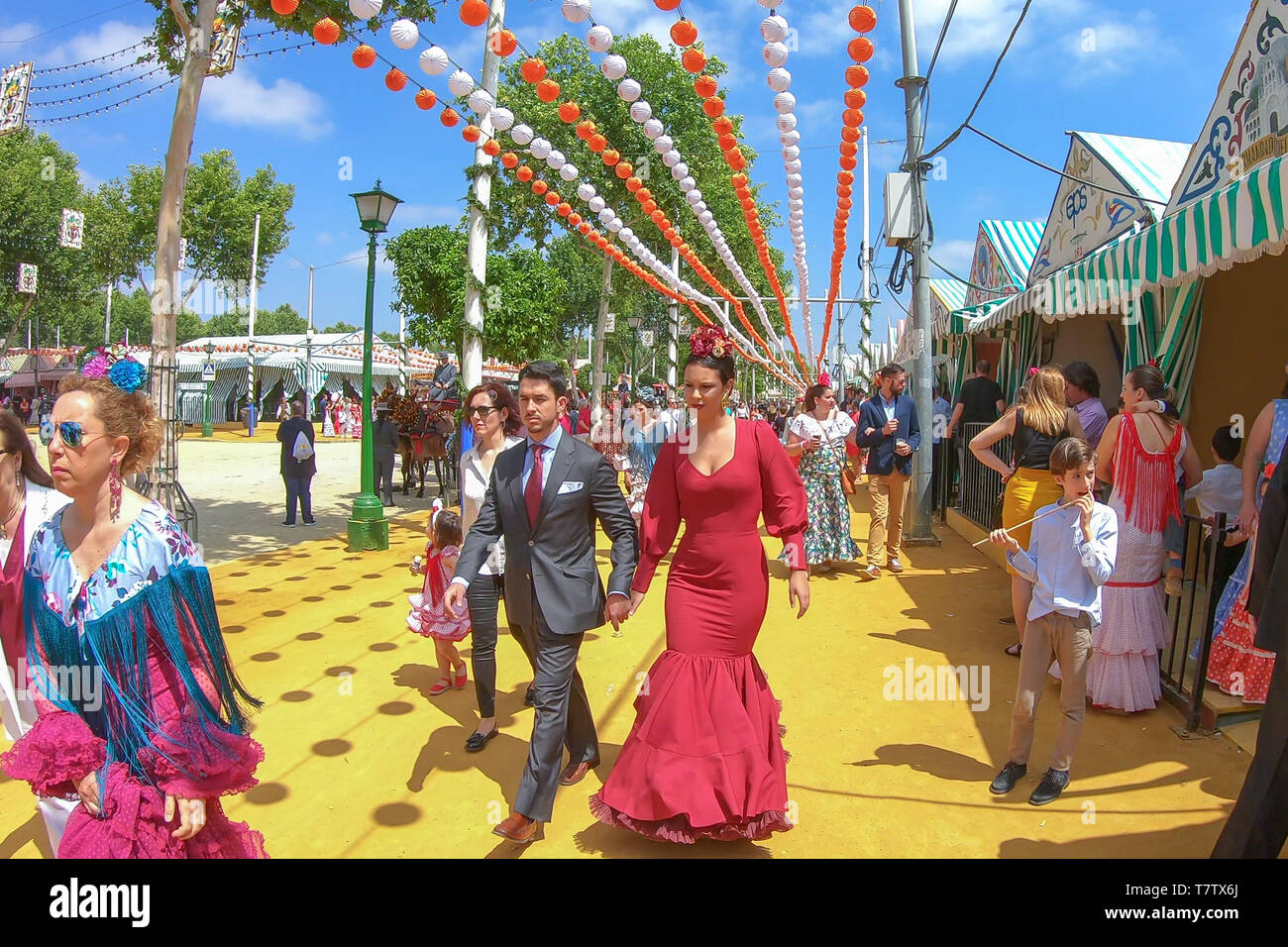 Seville, Spain - May 5, 2019: People walking by  the April Fair of Seville on May, 5, 2019 in Seville, Spain - Stock Image