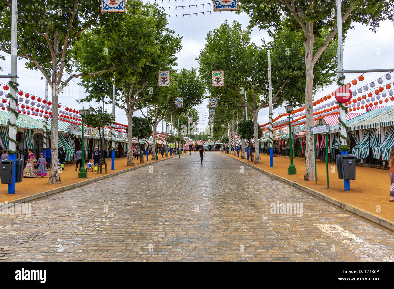 Seville, Spain - May 5, 2019: Almost empty street early in the morning during the the April Fair of Seville on May, 5, 2019 in Seville, Spain - Stock Image