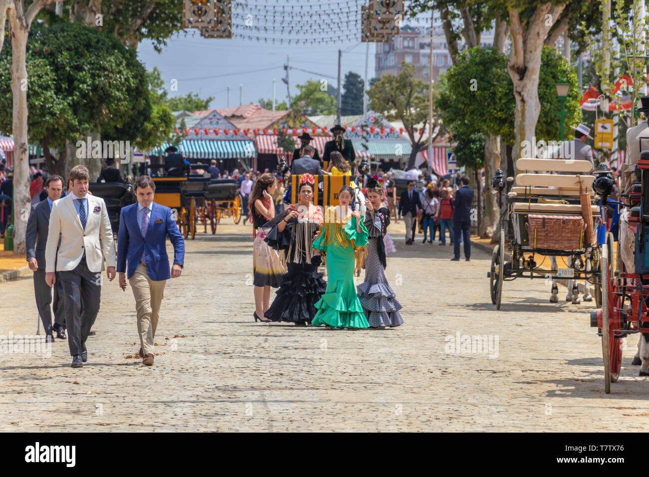 Seville, Spain - May 5, 2019: Young and beautiful women during the the April Fair of Seville on May, 5, 2019 in Seville, Spain - Stock Image