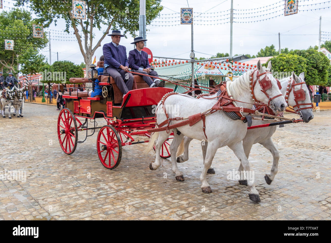 Seville, Spain - May 5, 2019: Horse drawn carriage during the the April Fair of Seville on May, 5, 2019 in Seville, Spain - Stock Image