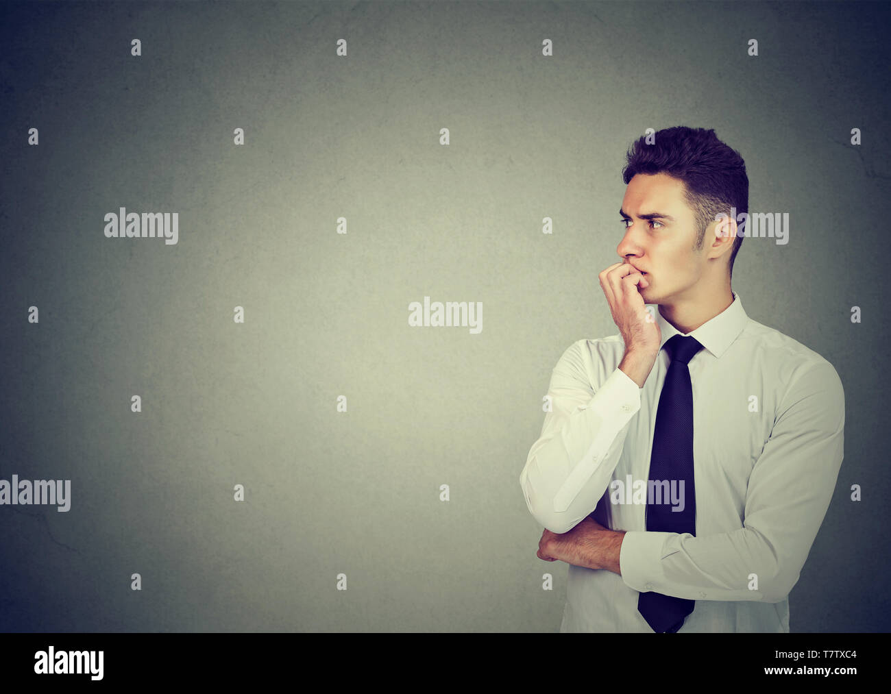 Portrait of an anxious young businessman looking sideways Stock Photo