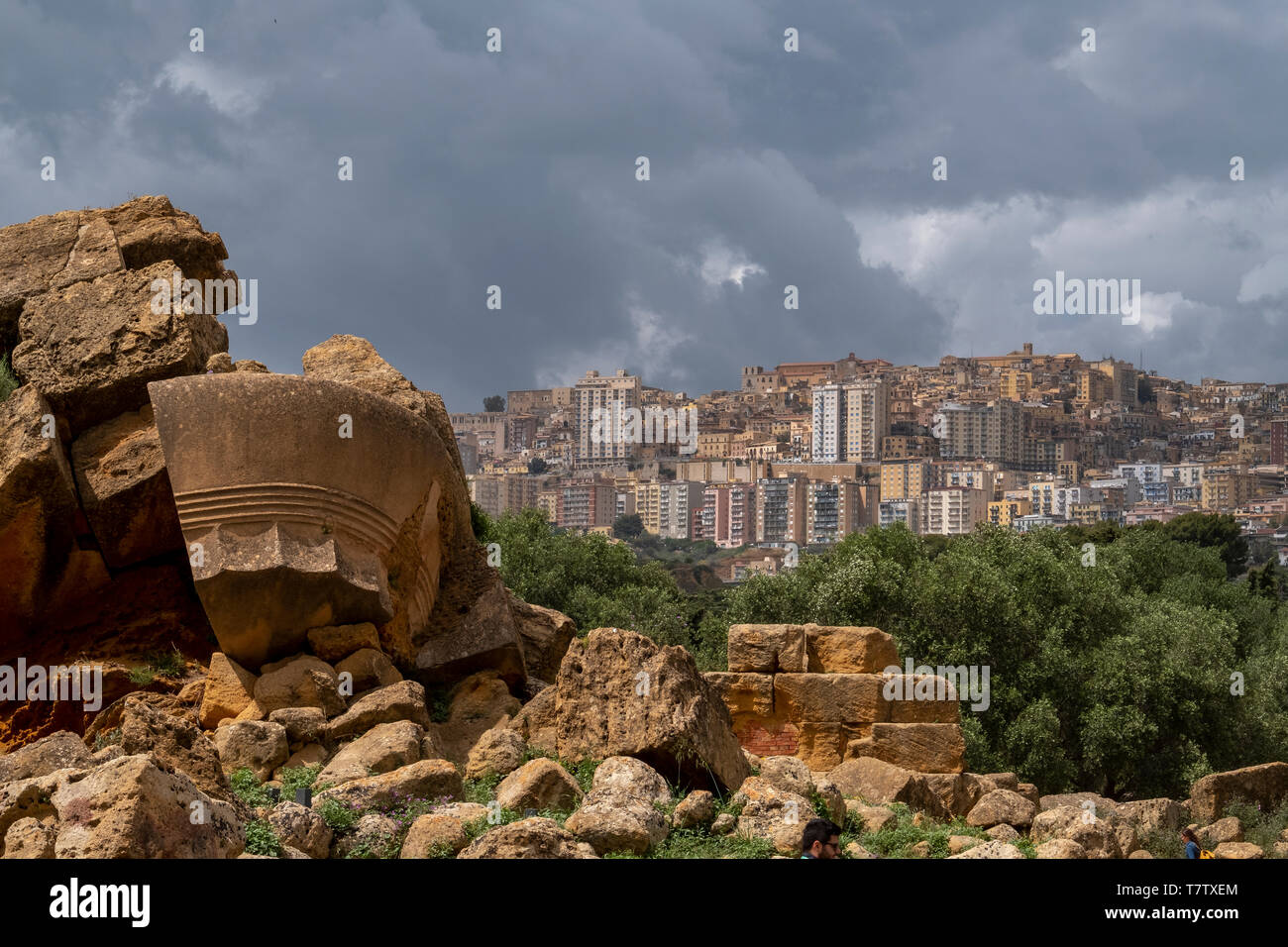 The temple of Olympian Zeus, in the valley of the Temples, in the ancient Acragas, Sicily with the modern city of Agrigentoin the distance. - Stock Image