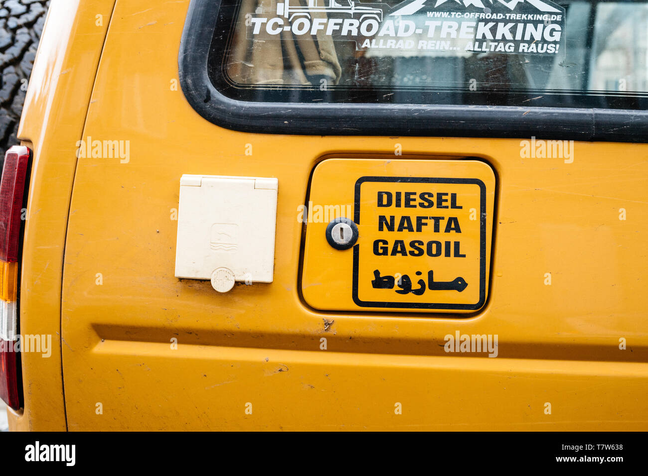 Strasbourg, France - Dec 27, 2017: New vintage yellow Land Rover Defender Camel Trophy with Diesel, Nafta Gasoil and arabic script detail on the gas tank Stock Photo