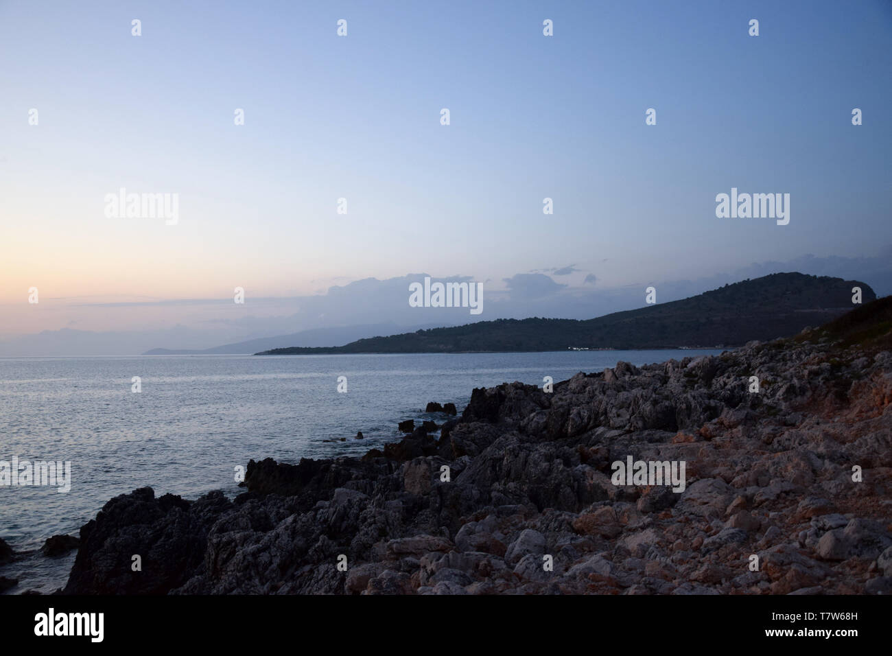 Golden hour Sundown, with view to Korfu island. Sunset on the beach in Ksamil near Saranda, Albania. - Stock Image