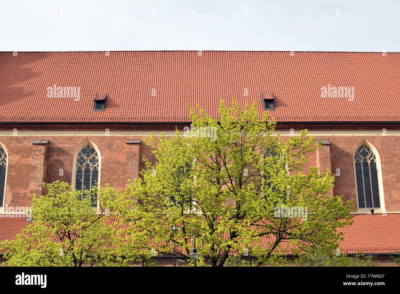 Gothic church wall and roof. Brick gothic wall. - Stock Image