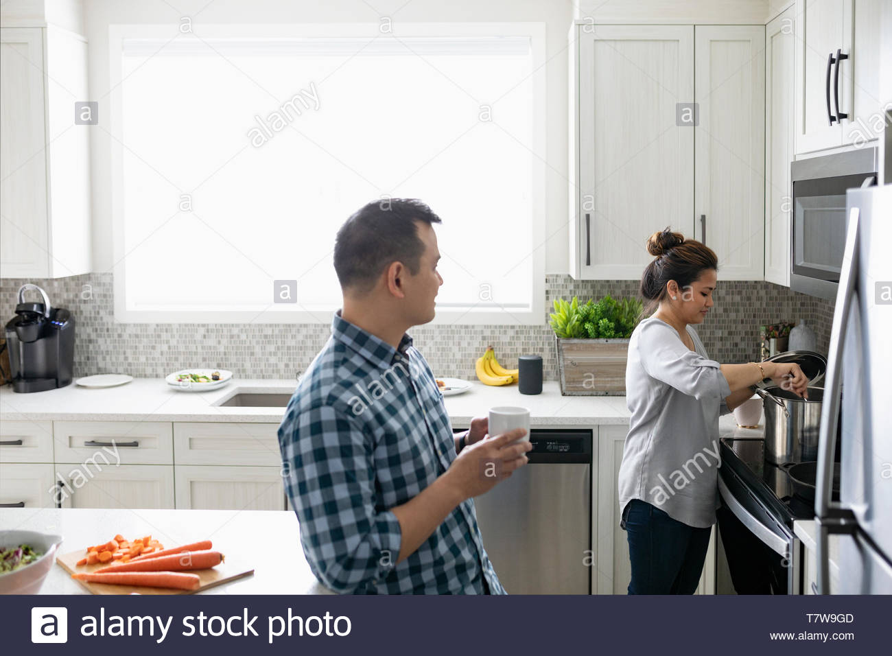 Couple cooking in kitchen Stock Photo