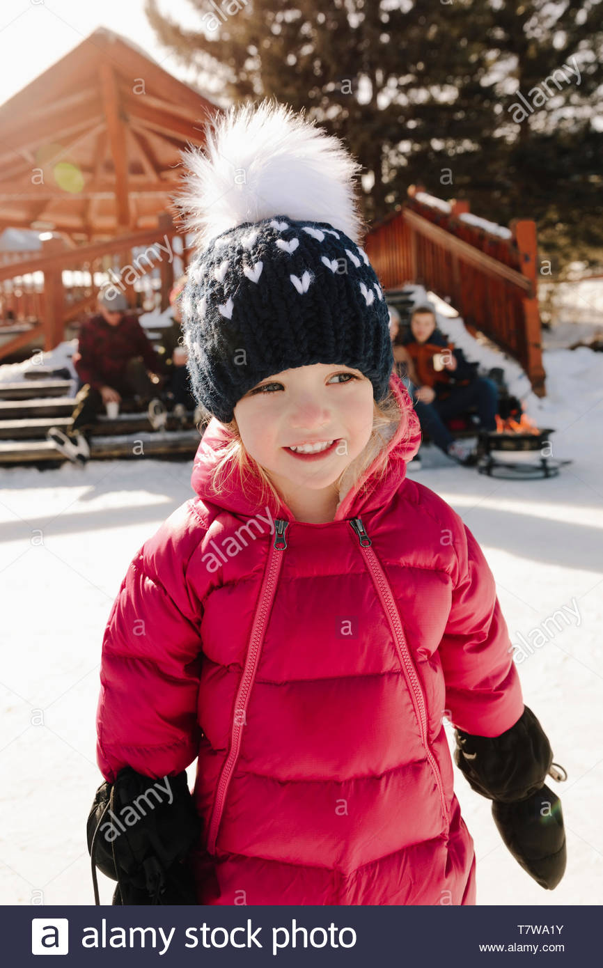 Cute, smiling girl ice skating - Stock Image