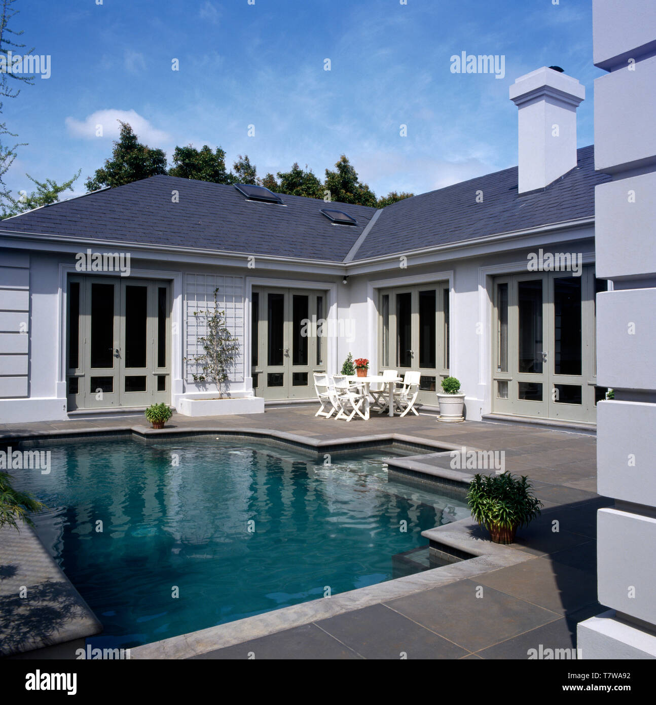 Modern Single Storey House Set Around A Small Swimming Pool Stock Photo Alamy