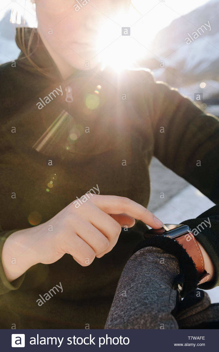 Female runner checking smart watch - Stock Image