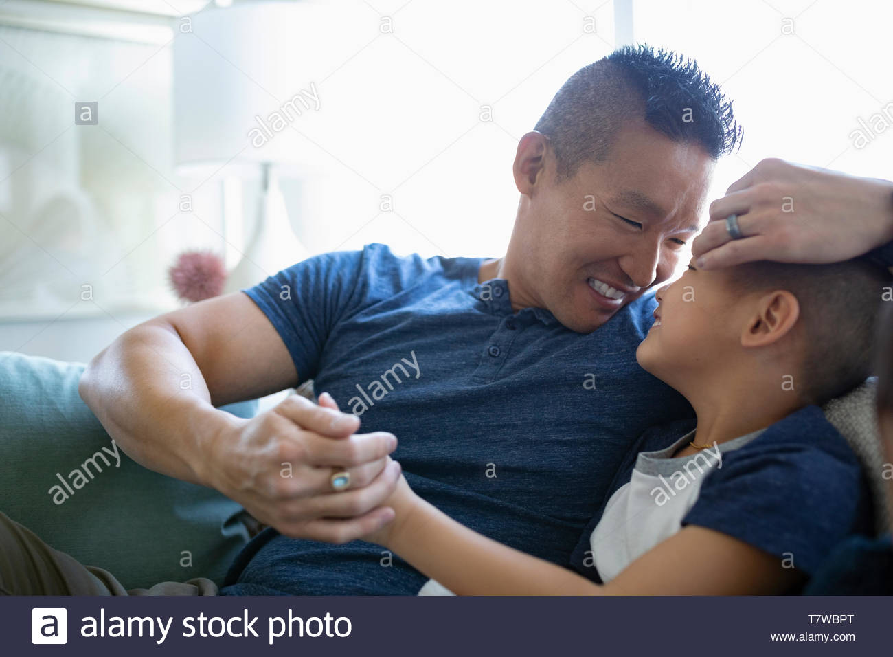 Affectionate, happy father and son - Stock Image