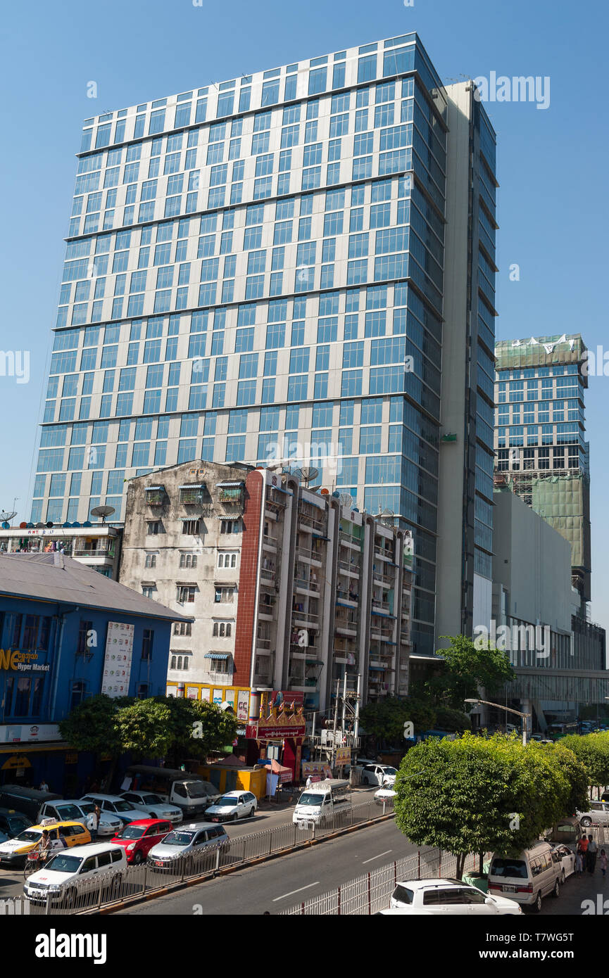 04.02.2017, Yangon, Myanmar, Asia - A modern office building and a luxury hotel are flanking the Junction City shopping mall in the downtown core. Stock Photo