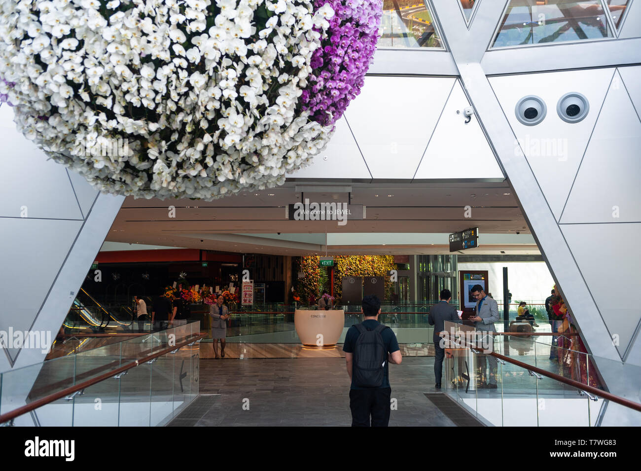 18.04.2019, Singapore, Republic of Singapore, Asia - People inside the new Jewel Terminal at Changi Airport, designed by Moshe Safdie Architects. - Stock Image
