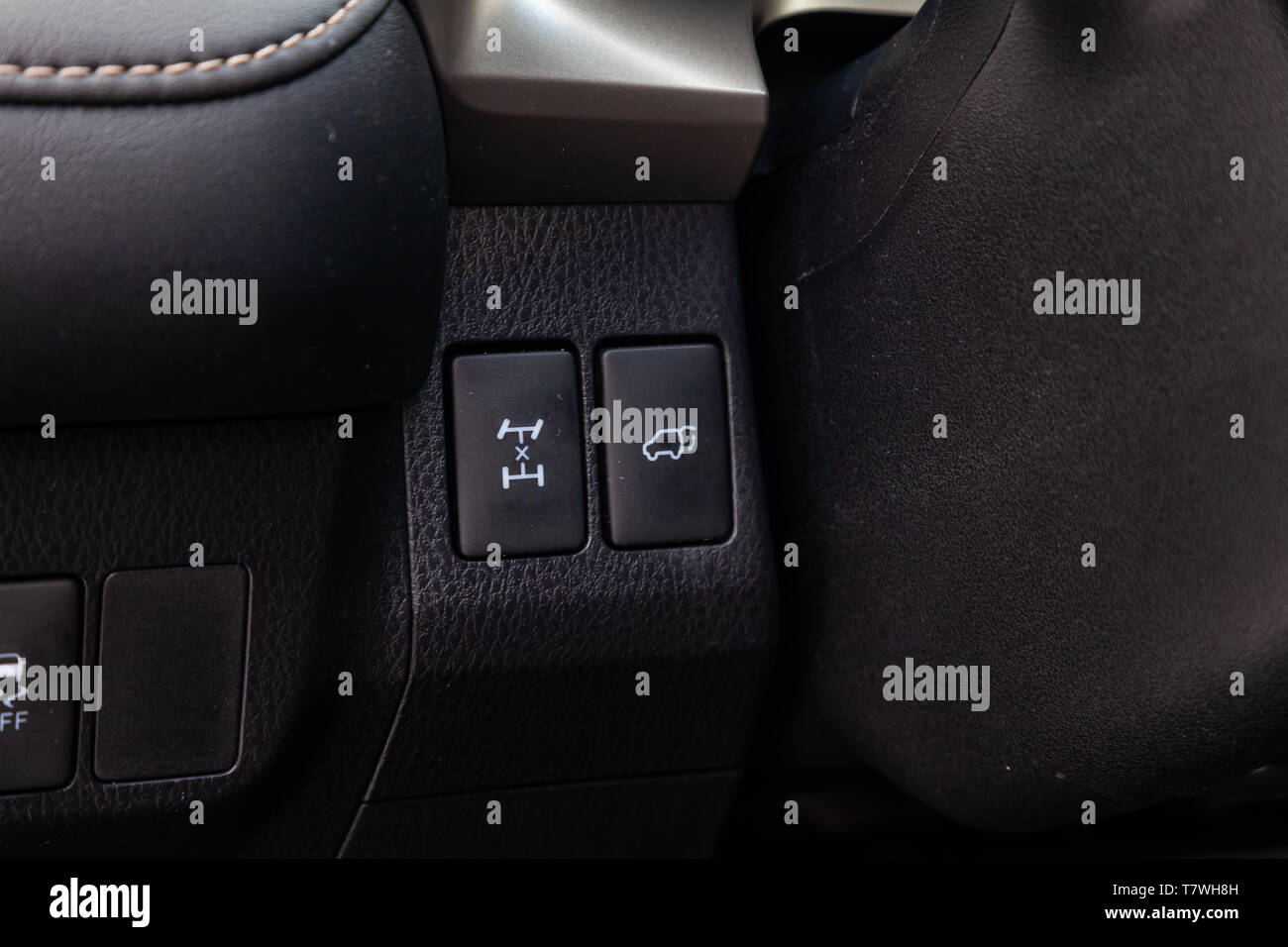 Interior view with electric trunk adjustment button differential lock of luxury very expensive new black car after cleaning in the vehicle repair work - Stock Image