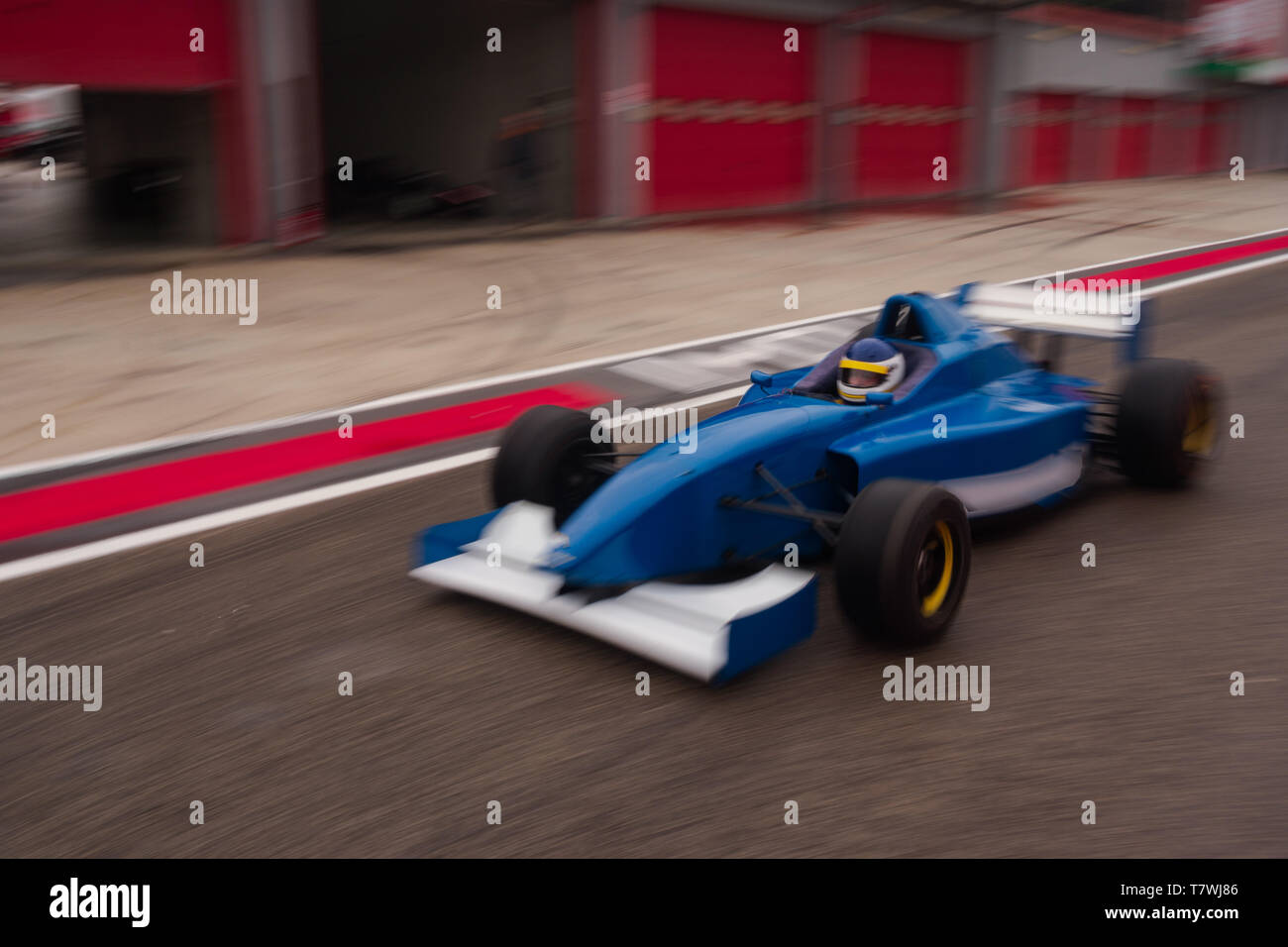 formula car is approaching the track from the pitlane Stock Photo