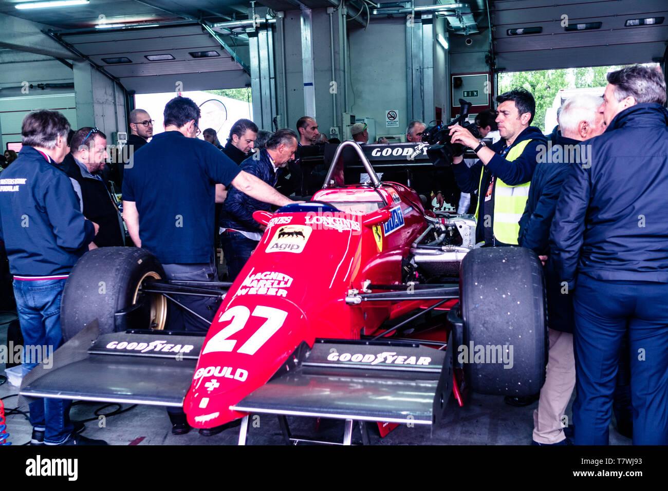 Vintage Ferrari is surrounding by fans Stock Photo
