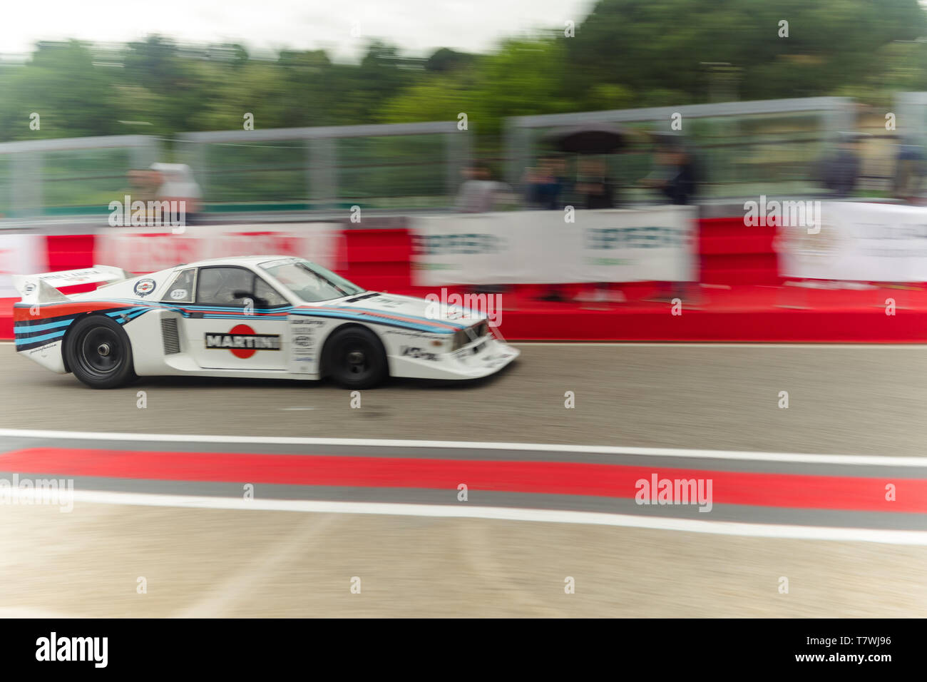 a fast car is leaving the pitlane Stock Photo
