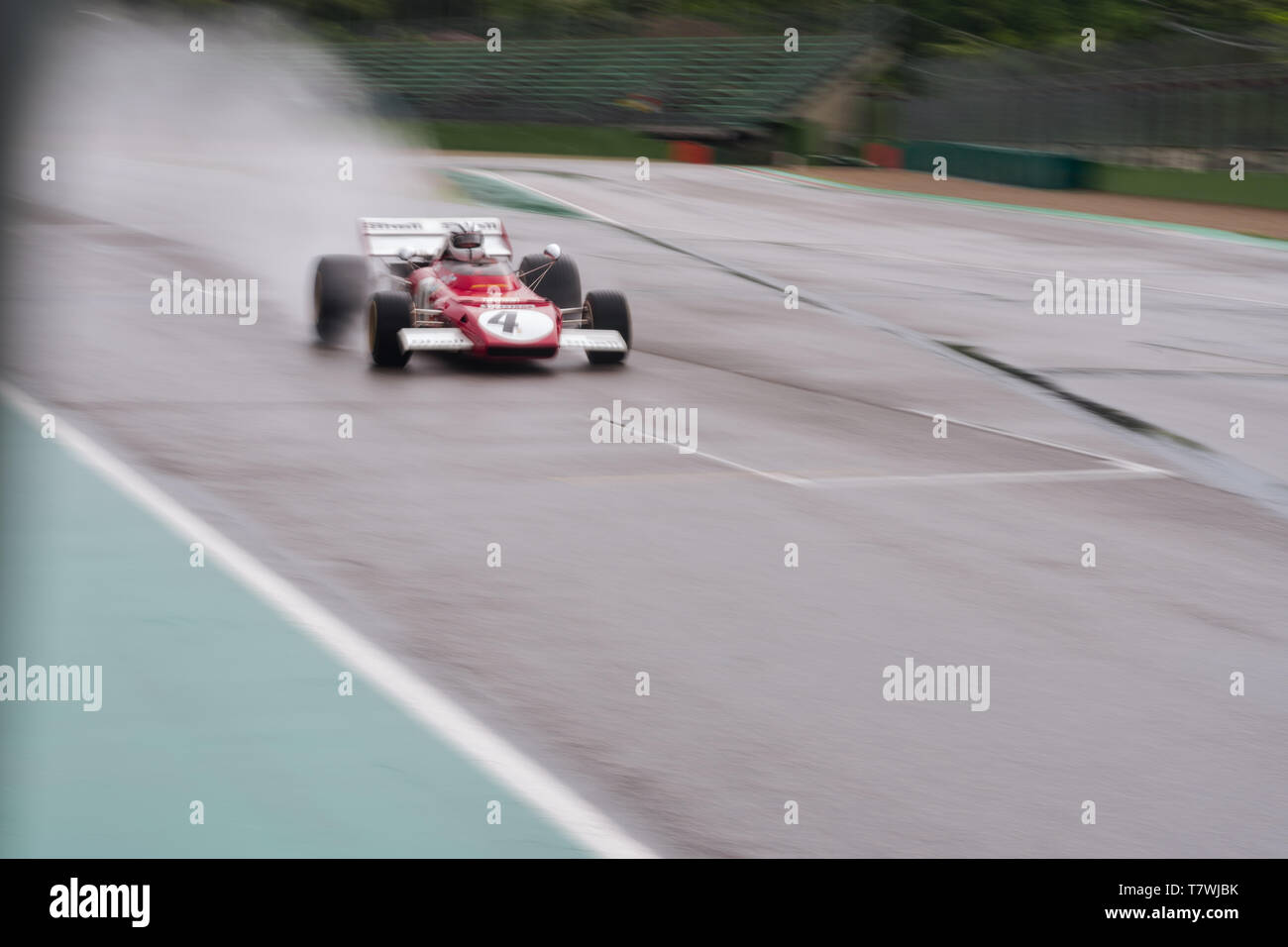 vintage formula one car is flying on a wet track, panning photo Stock Photo