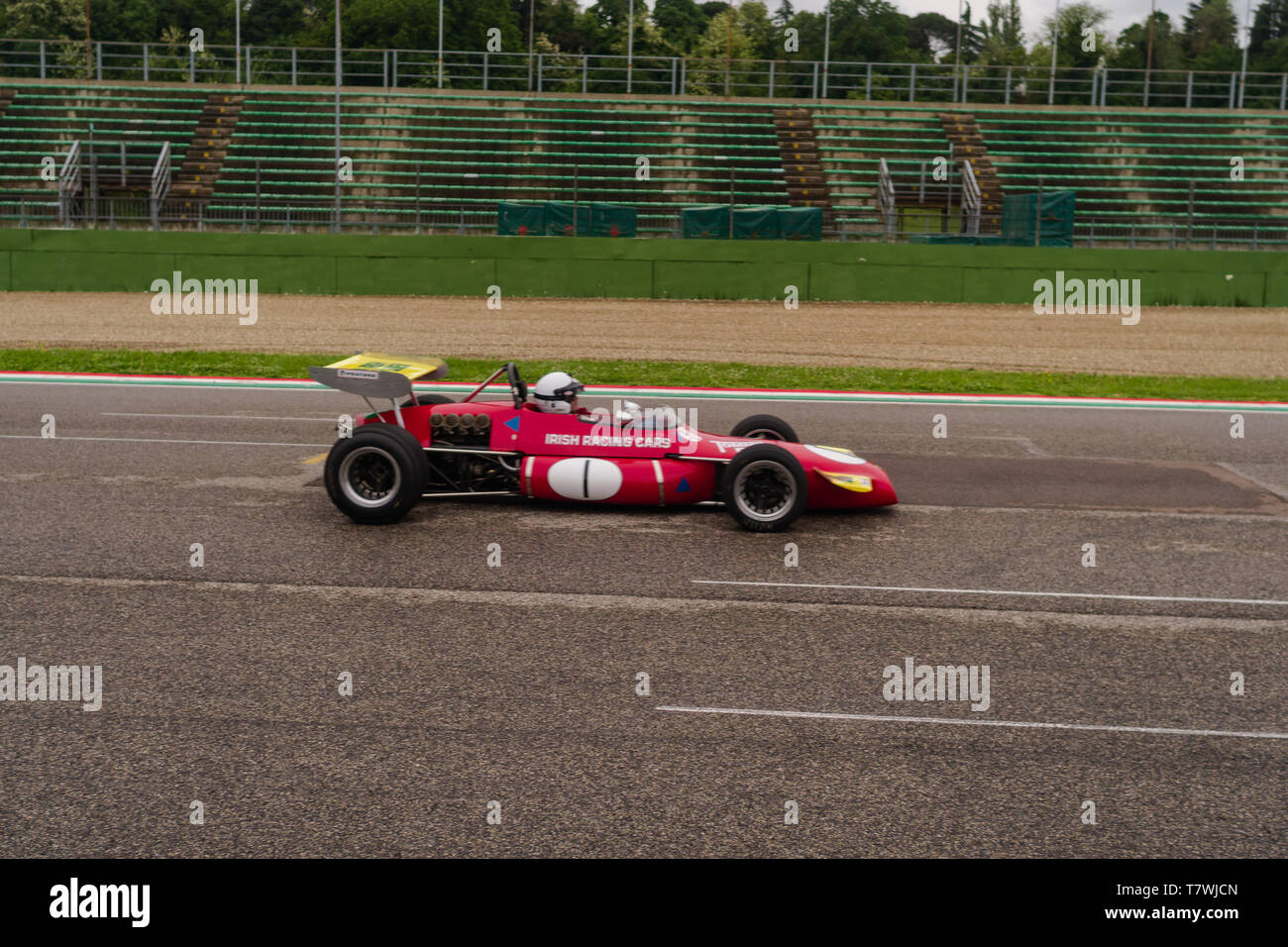 an early day formula one car is flying fast on the main straight Stock Photo