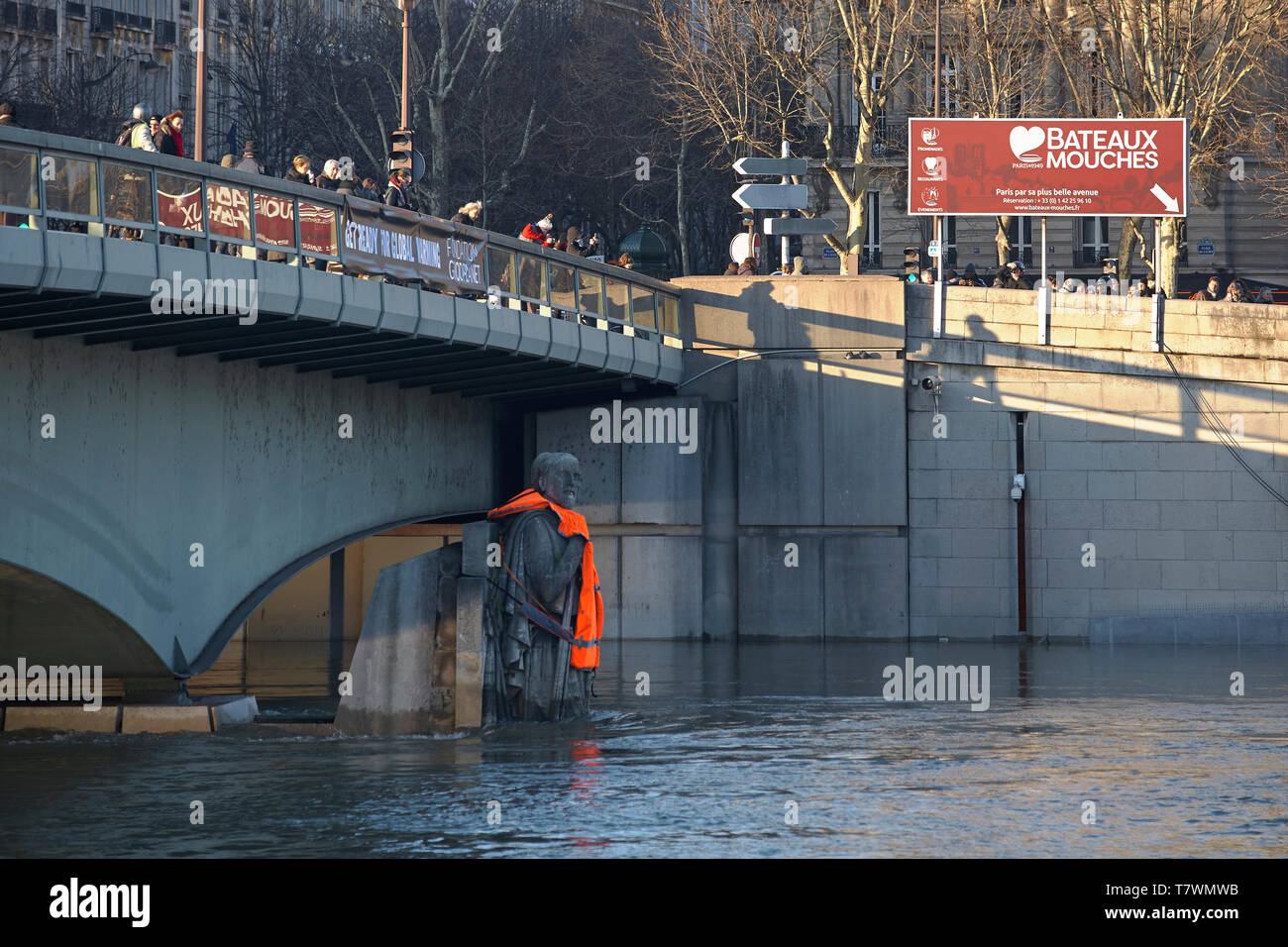 France, Paris, area listed as World Heritage by UNESCO, Seine Flood in January 2018, Alma bridge Zouave wearing a life jacket put by activists of Good Planet foundattion prostesting against global warming - Stock Image
