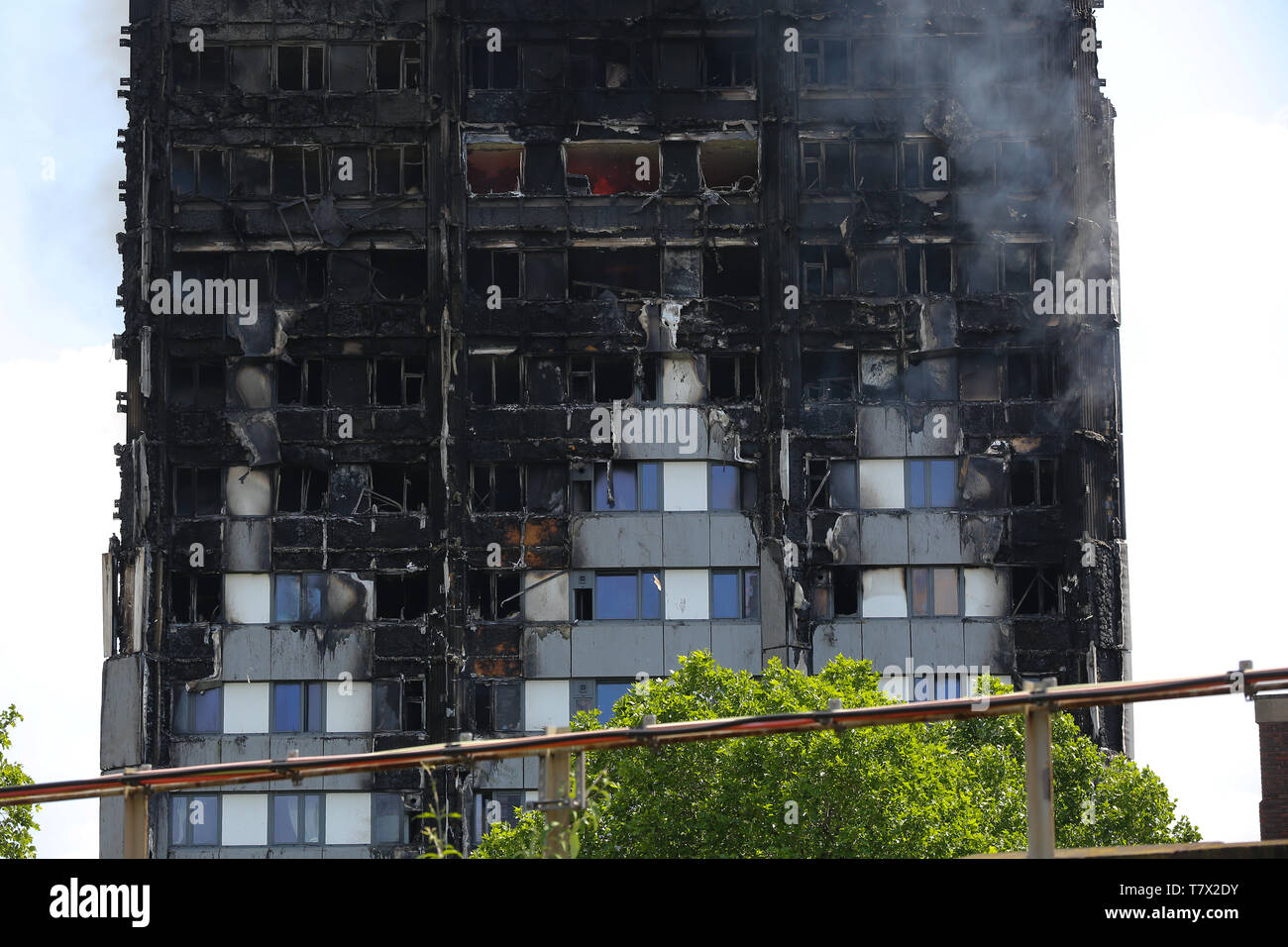 24-storey Grenfell Tower block of flats seen on fire in North Kensington, West London. On 14 June 2017, a fire broke out in the 24-storey Grenfell Tower block of flats in North Kensington, West London where 72 people died, more than 70 others were injured and 223 people escaped. The UK Government is to fund an estimated £200 million to replacement of unsafe Grenfell style cladding on around 170 high-rise private residential buildings after private building owners failed to take action. Communities Secretary James Brokenshire said inaction from building owners had compelled the government to ac - Stock Image
