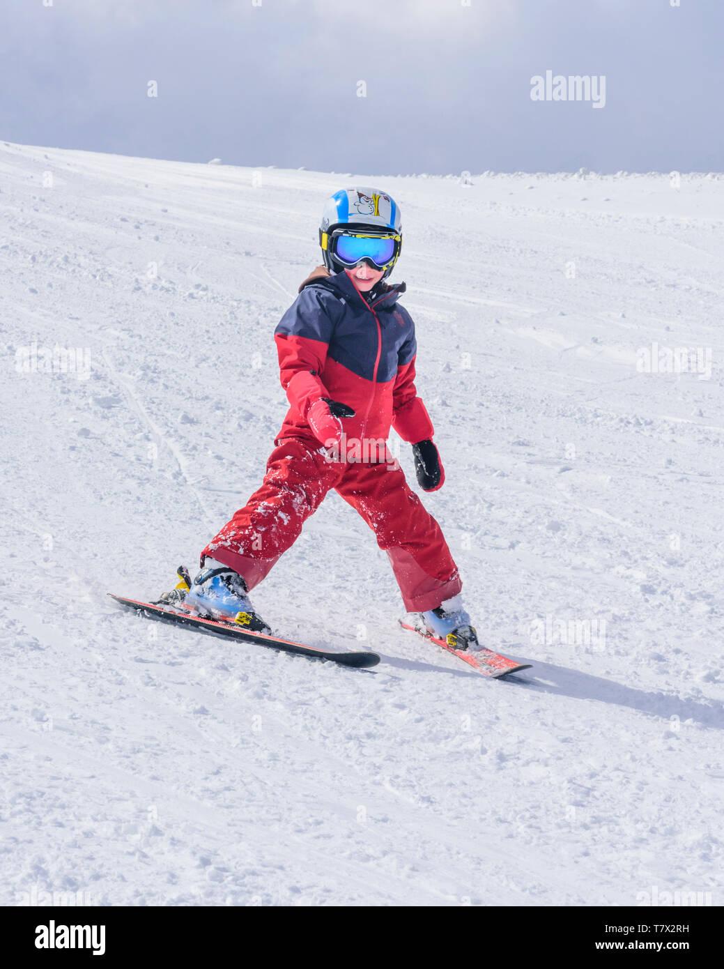 Cute little boy skiing on slope Stock Photo