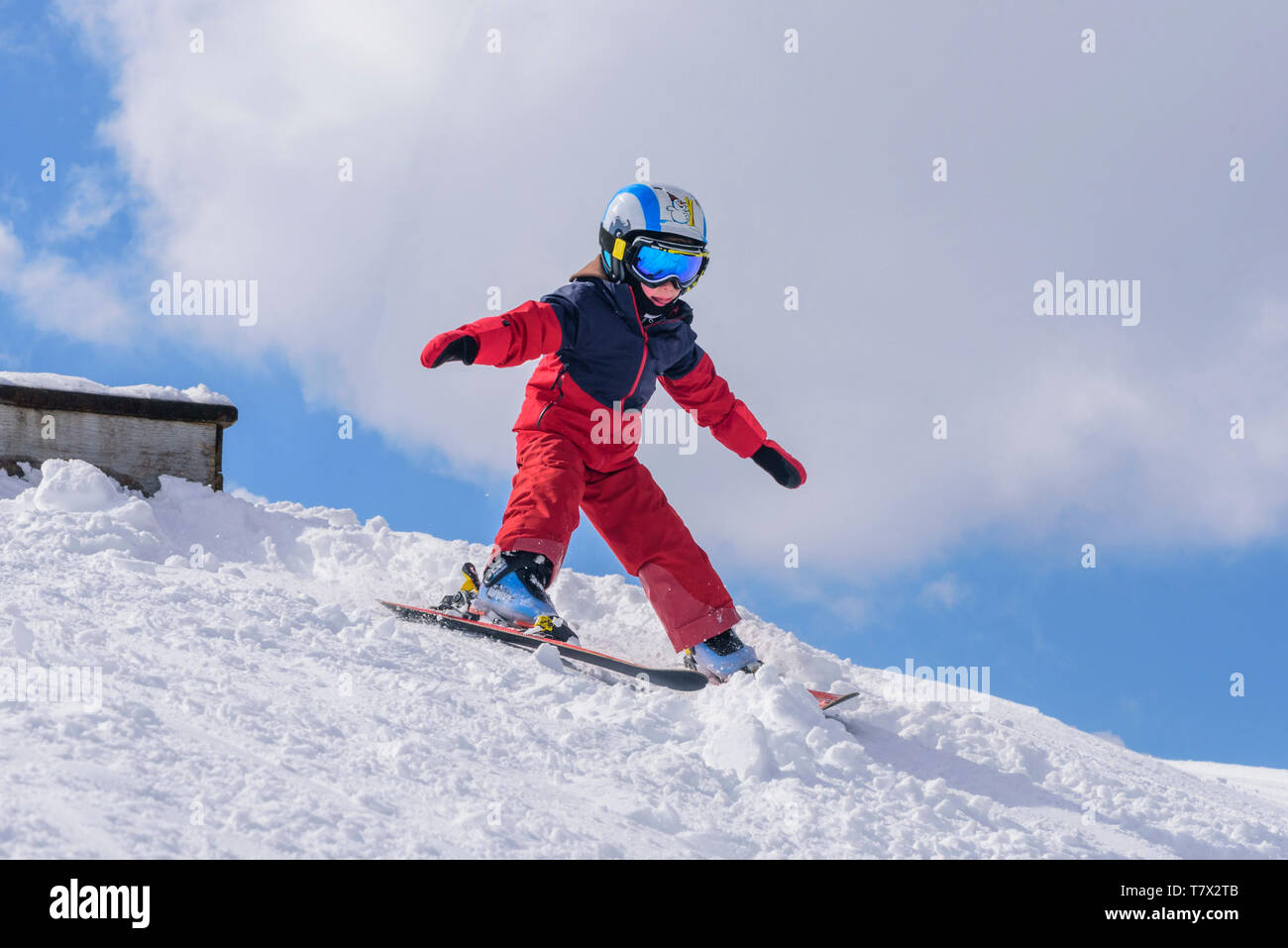 Cute little boy skiing on slope Stock Photo