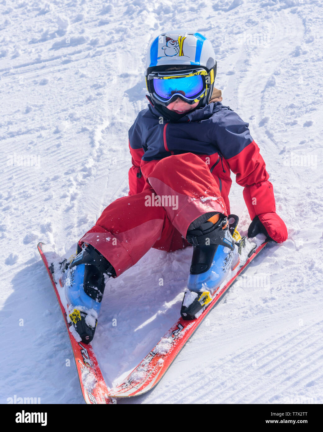 Cute little boy skiing on slope - Stock Image