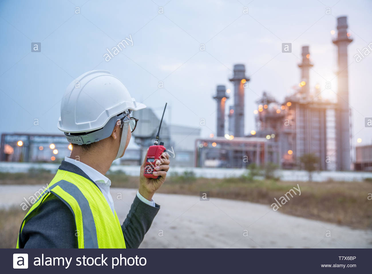 Electrical engineer working at power plant with walkie-talkie or radio communication, Power Industrial concept. Stock Photo