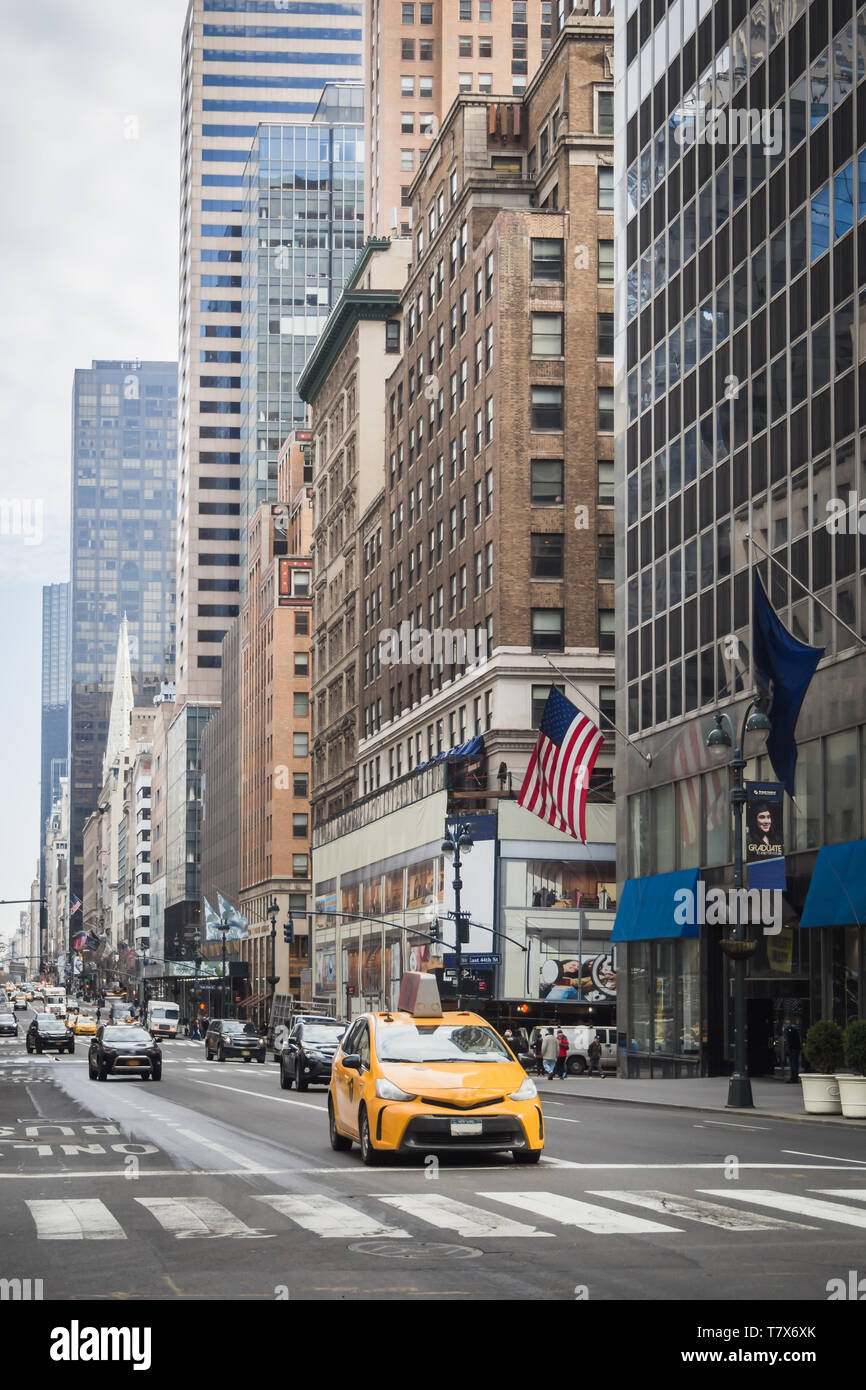Yellow Cab and morning traffic on the streets of Manhattan in New York Stock Photo