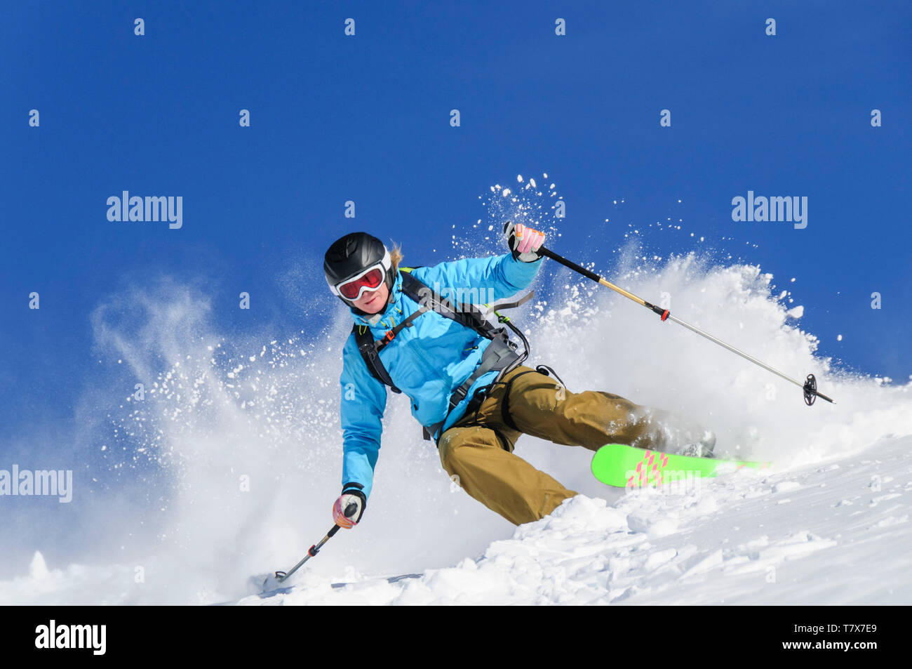 Sporty young woman skiing on the glaciers of Monte Rosa - Stock Image