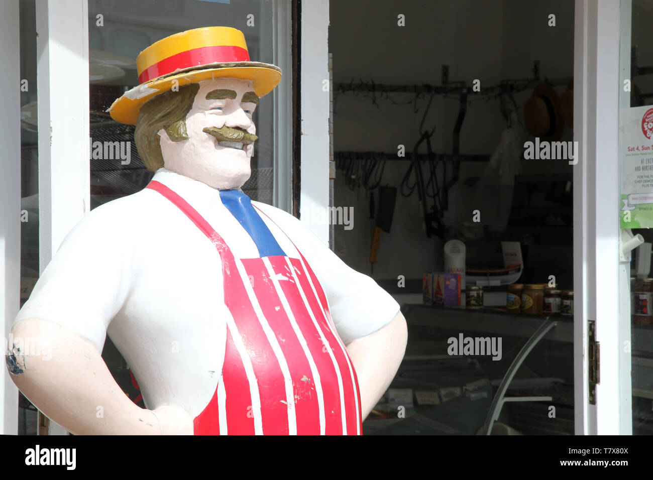 Lyme Regis, Dorset - Antique, life size, jolly butcher statue standing outside butchers shop in the daytime - Stock Image