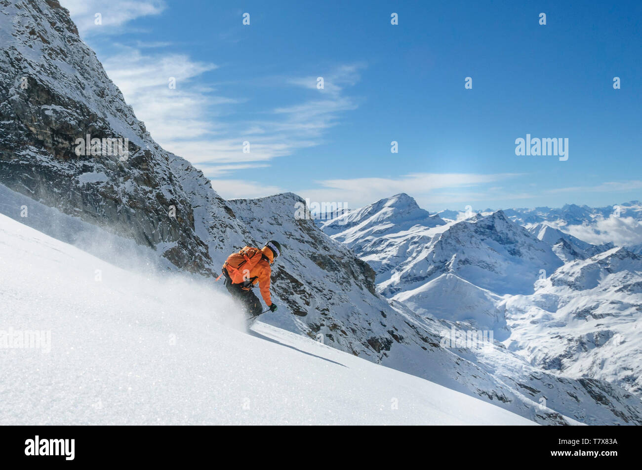 Expert on alpine skis skiing on the glaciers of Monte Rosa near Gressoney Stock Photo