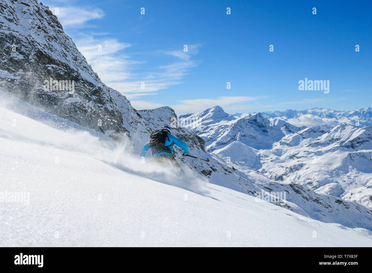 Sporty young woman skiing on the glaciers of Monte Rosa Stock Photo