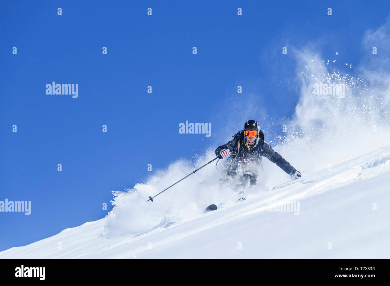 Expert on alpine skis skiing on the glaciers of Monte Rosa near Gressoney - Stock Image